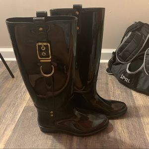 Black and gold coach rain boots